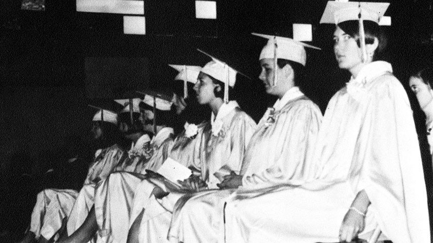 Black and white photo of first graduating class of 7 girls