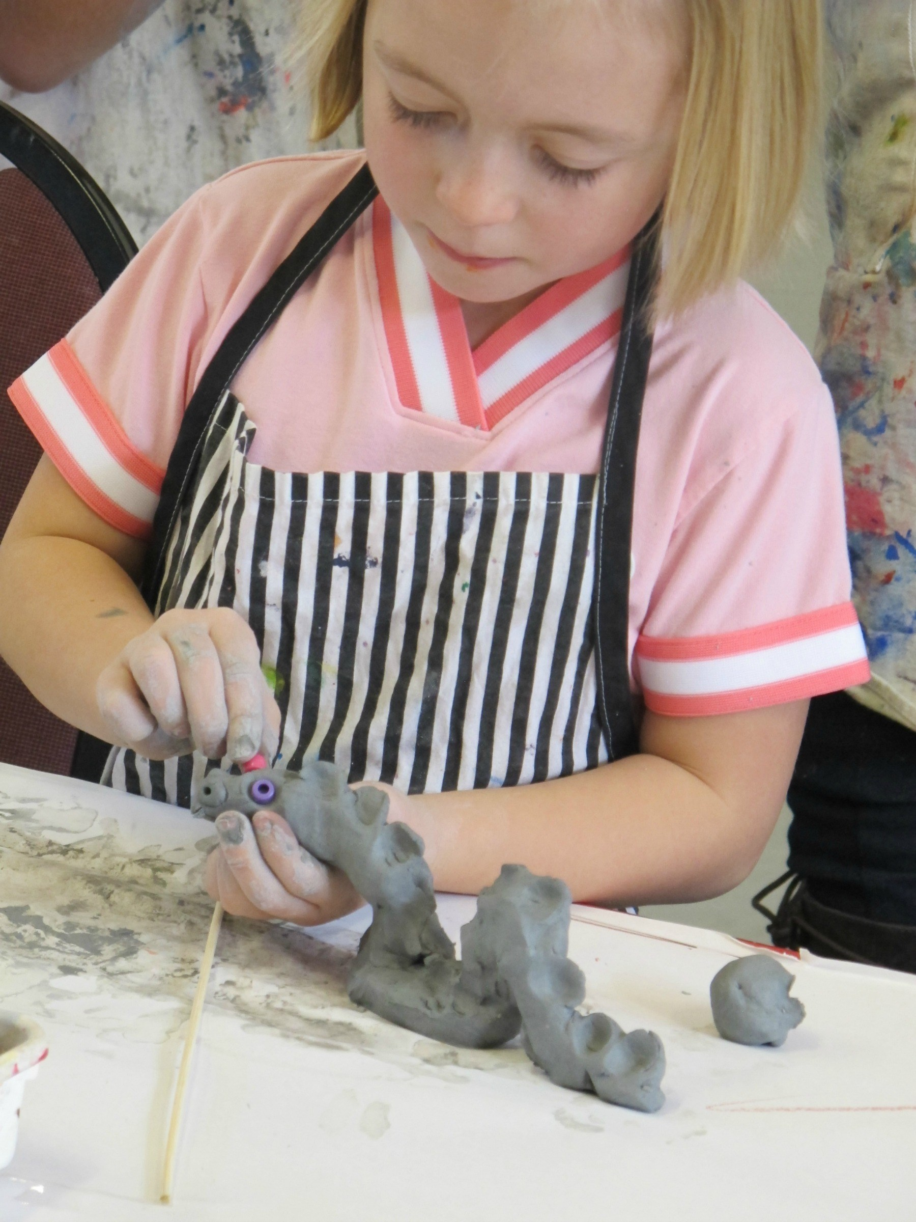Student working with clay.