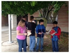 Students use Little Free Library
