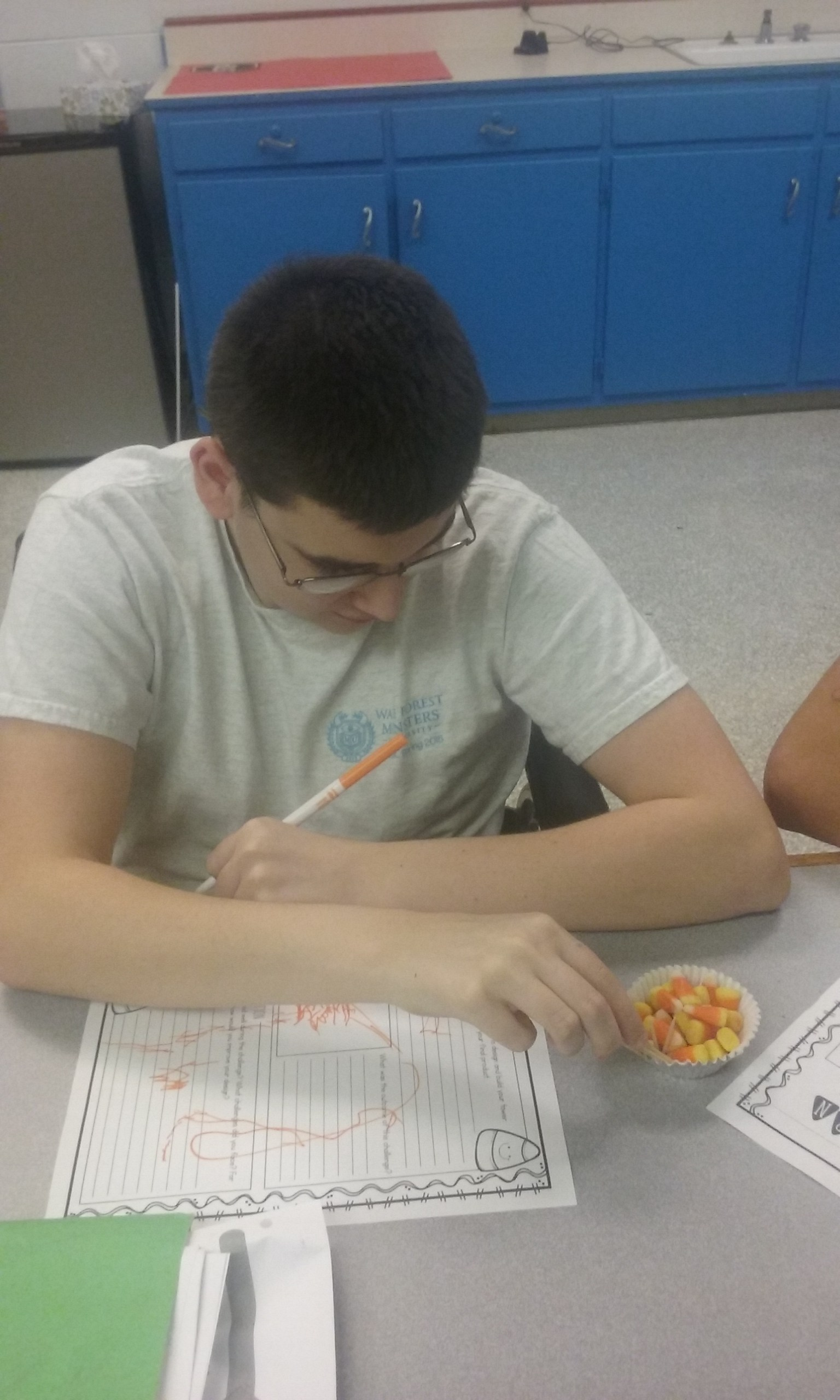 Student doing candy corn activity