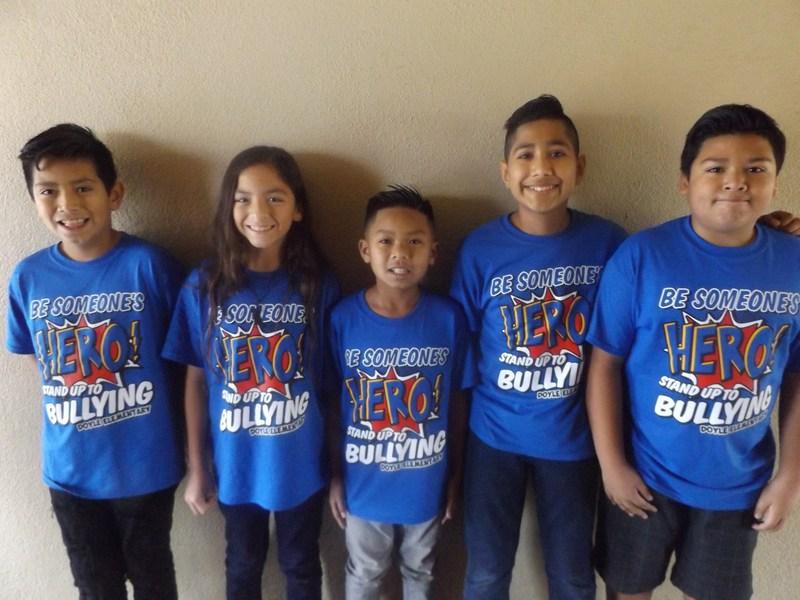 Doyle students wearing HERO shirts