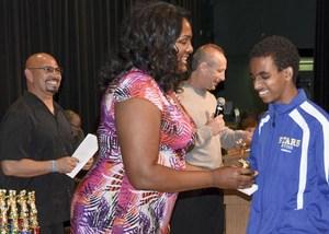 Kym Hampton presenting an award to student
