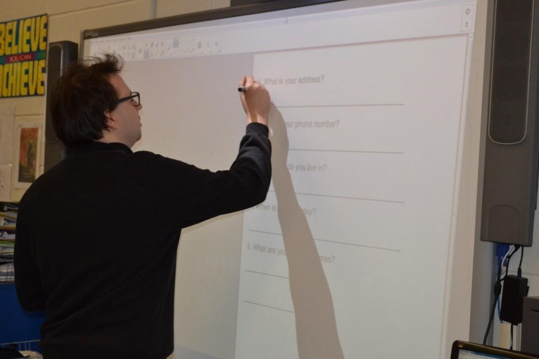 Student writing on SMARTBoard