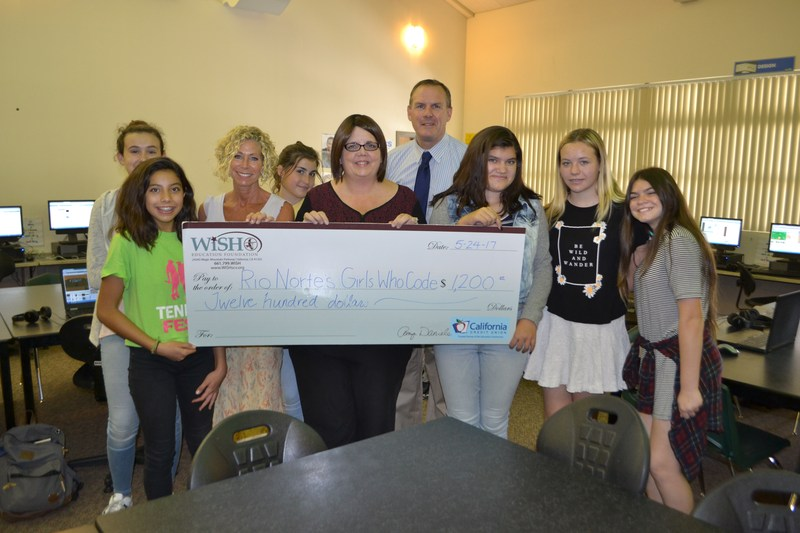 Rio Norte's Girls Who Code accepting an award from the WiSH Education Foundation