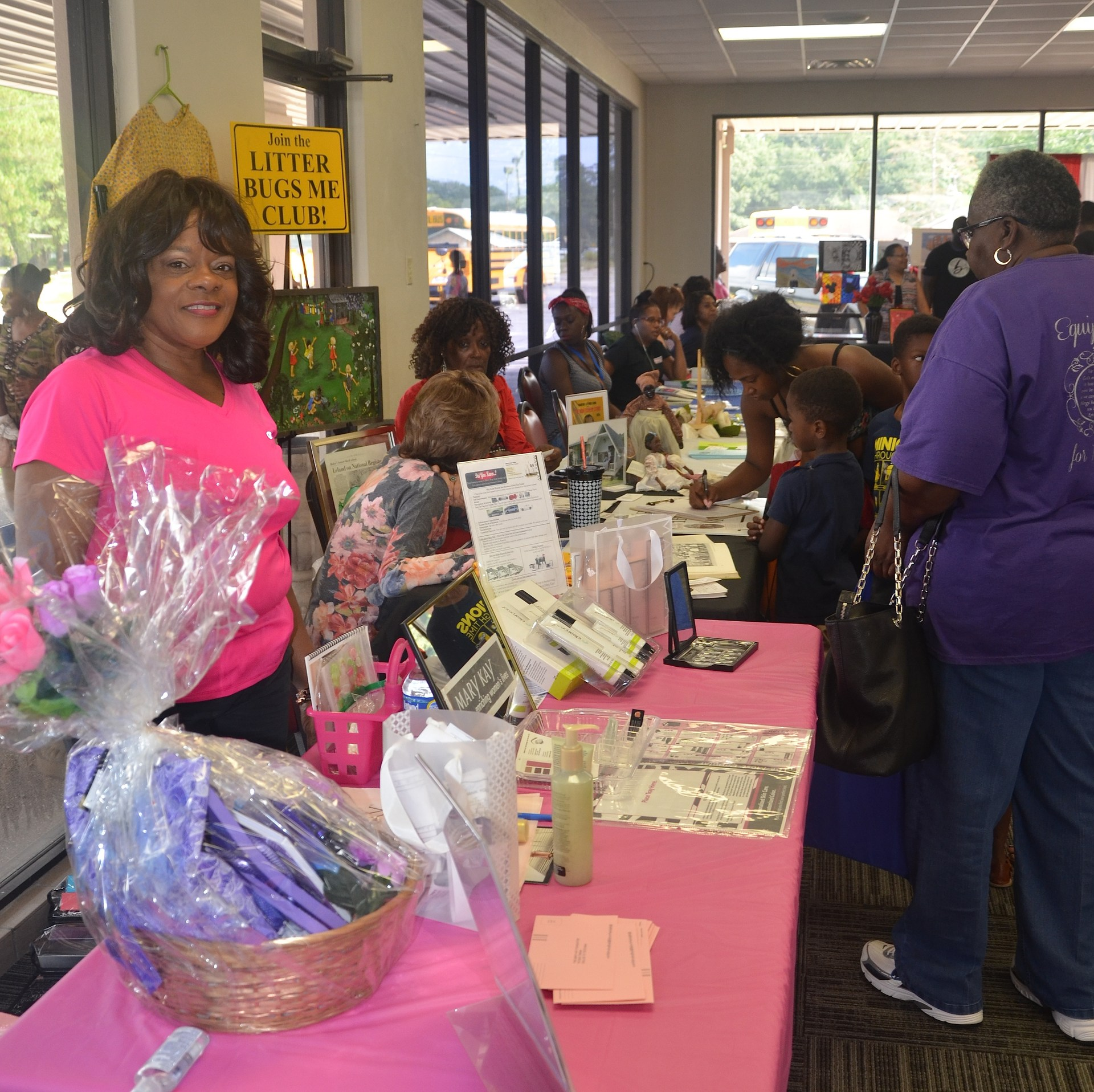 Participants at the 2017 Back to School Expo looking at some of the beautiful items on a table at the Expo