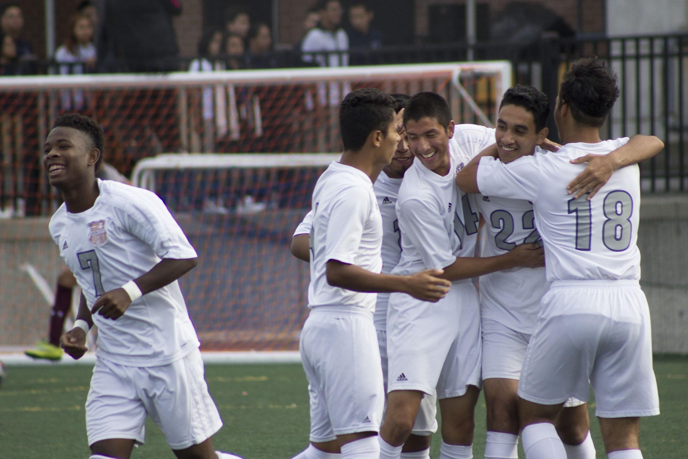 boys soccer team playing