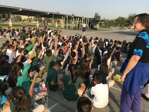 large group of students gathered for assembly outside, image 1