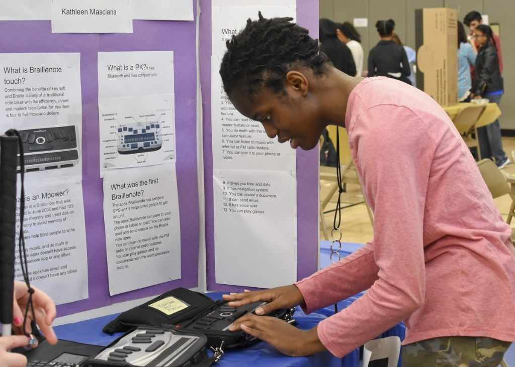 Student using an iPad at the Science Fair.