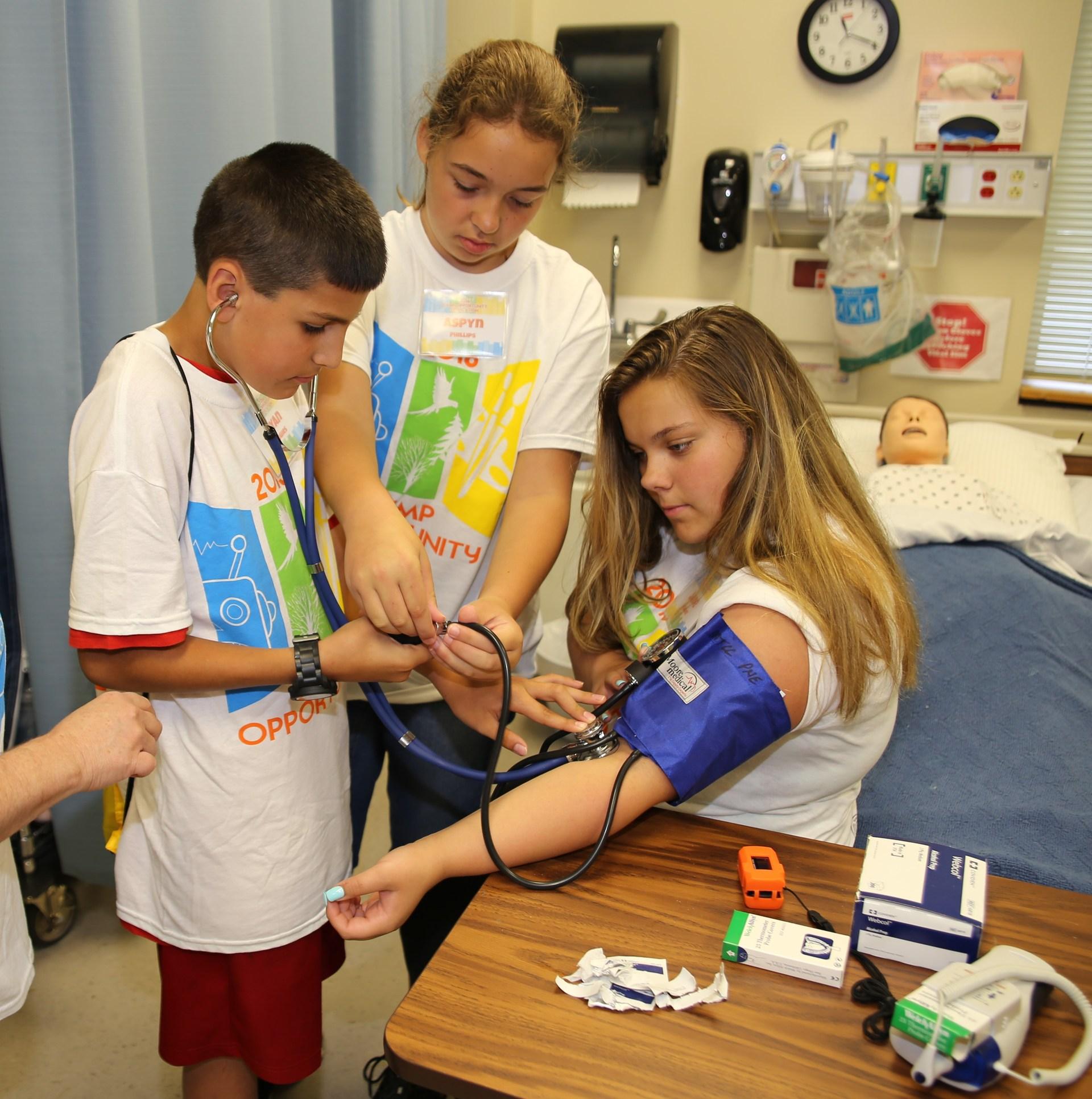 Students taking blood pressure