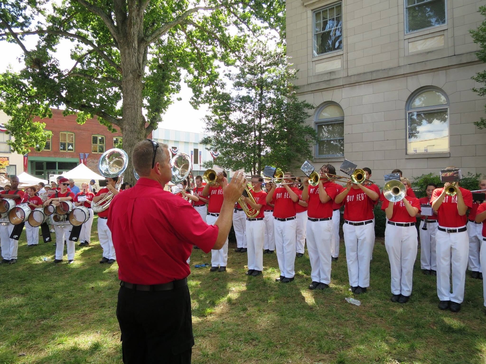Band performing a song at Newton Square