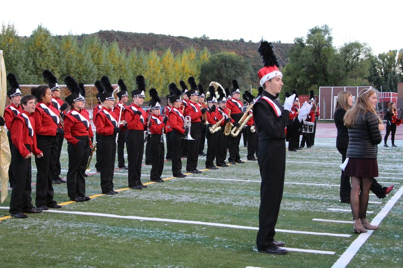 Marching band students lined up on the field at DHS Homecoming.