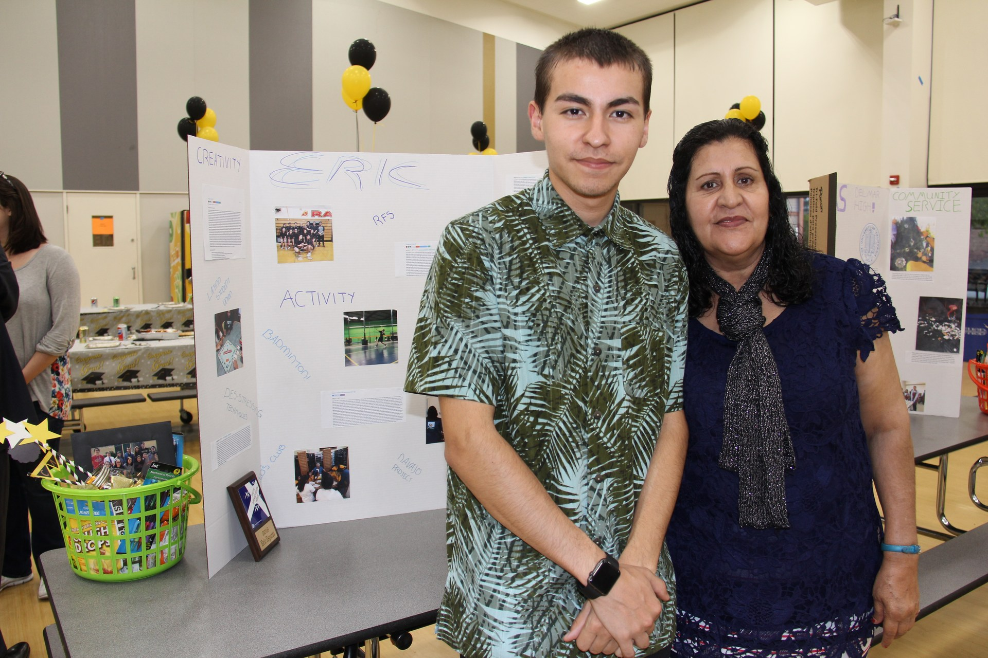 Image of IB Diploma Candidate with his Mom and presentation board at CAS Celebration Event