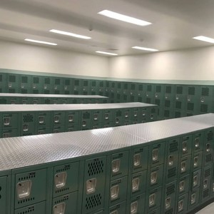 The girls locker room is ready for the new school to open.