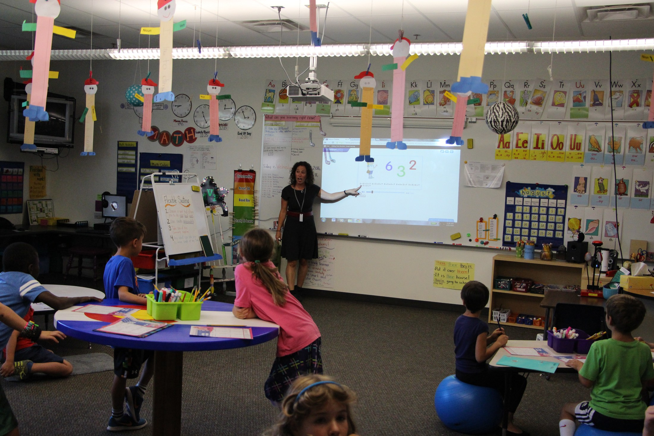 Teacher Corey Rosen uses a smart board in her class.