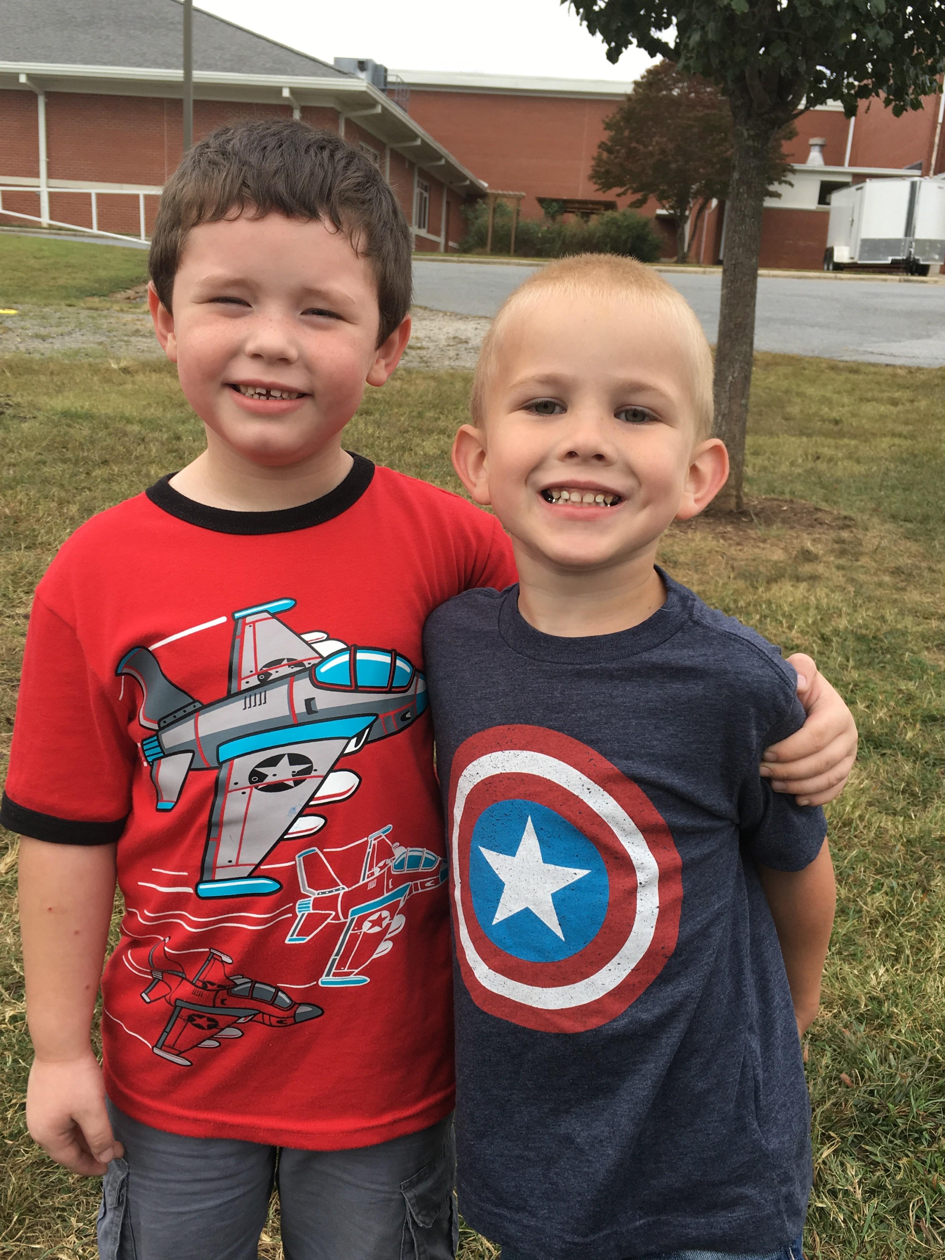 two friends dressed as superheroes
