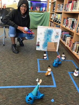 Mtn. View High School Senior Tamakia Colquitt prepares Sphero robot game for De Anza Elementary students.