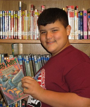 Student Michael Pena with book