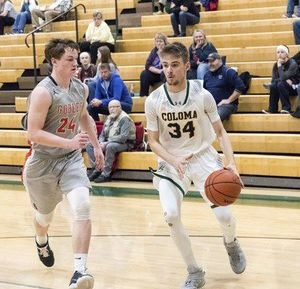 Coloma's Adam Hearn (34) drives to the basket against Gobles' Tyler Hunt (24)