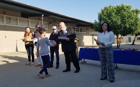 Principal Russo presenting student award