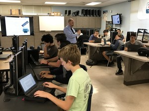 Mr. Bayne teaching ACES students in the new space