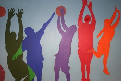 Mural of people playing basketball