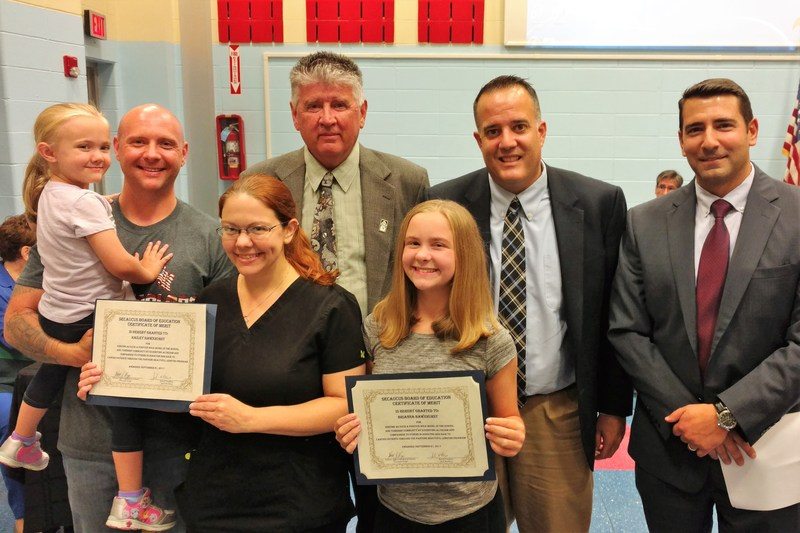 Sisters Brianna and Hailey Hawxhurst Honored for the Donation of their Hair for Cancer Patients at the Board of Education's Showcase of Success Thumbnail Image