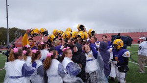 Cheerleaders and football players celebrate after an OLSH win.