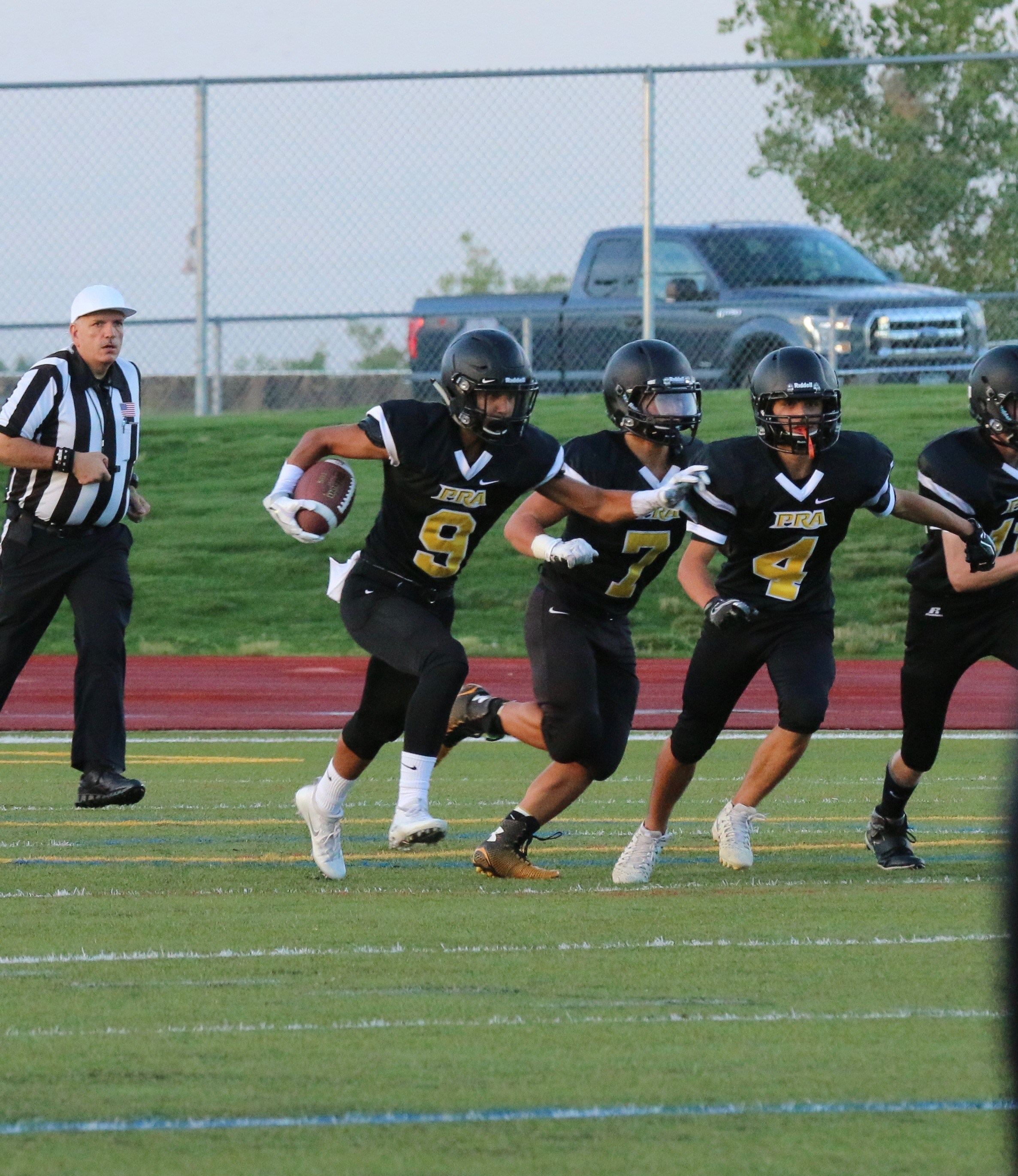 Football team running play