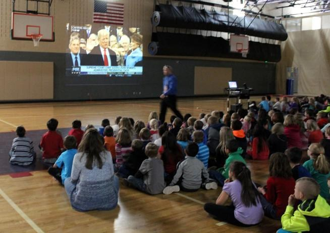 Harrison K-8 School students watch Friday as President Donald Trump takes the oath of office. (Sara Knuth / Daily Record)