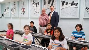 Kirk Clark donates to McAuliffe Elementary Music