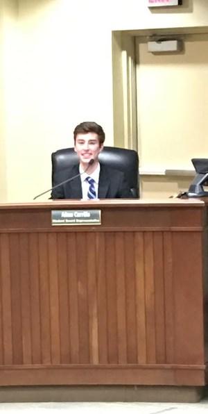 student school board representative seated with board