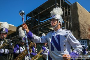 Student with baton leading the Northwestern Wildcats Marching Band