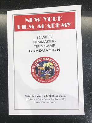 Image of the graduation program. Words on Page: New York Film Academy, 12-week filmmaking teen camp graduation. Academy logo, Saturday, April 28, 2018 at 5PM, 17 Battery Place, Screening Room 521, New York, NY 10004