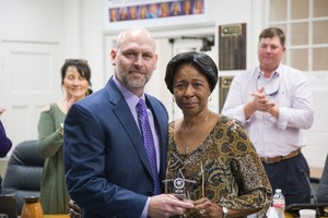 Superintendent Harkrider posing with MVP winner Virginia Nickerson