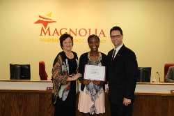 School Board President with Jasmine Mitchell and Principal Springer.jpg