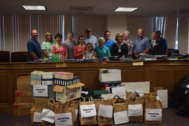 Those who donated at the school supply drive on August 29 stand with administrators of HCPS