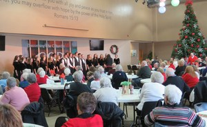 TKHS Honors Choir entertains guests at the annual senior holiday luncheon.
