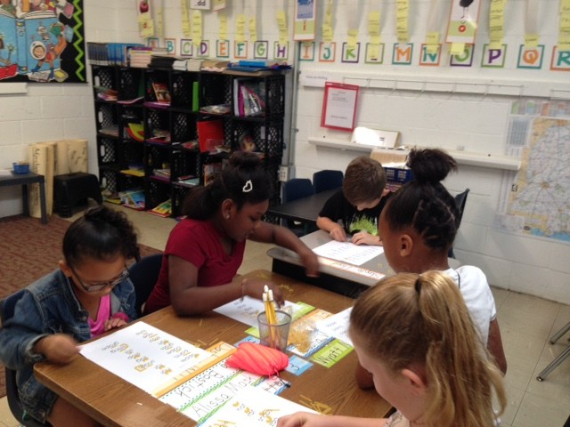 1st grade students working at tables
