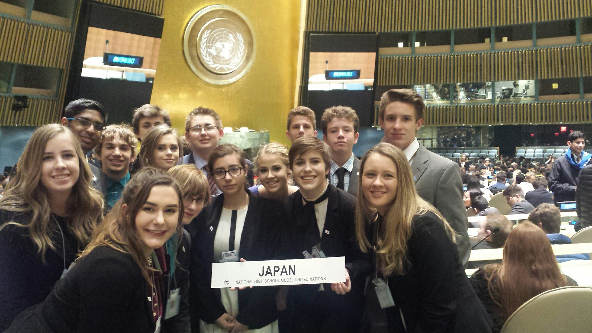 Students in UN room holding