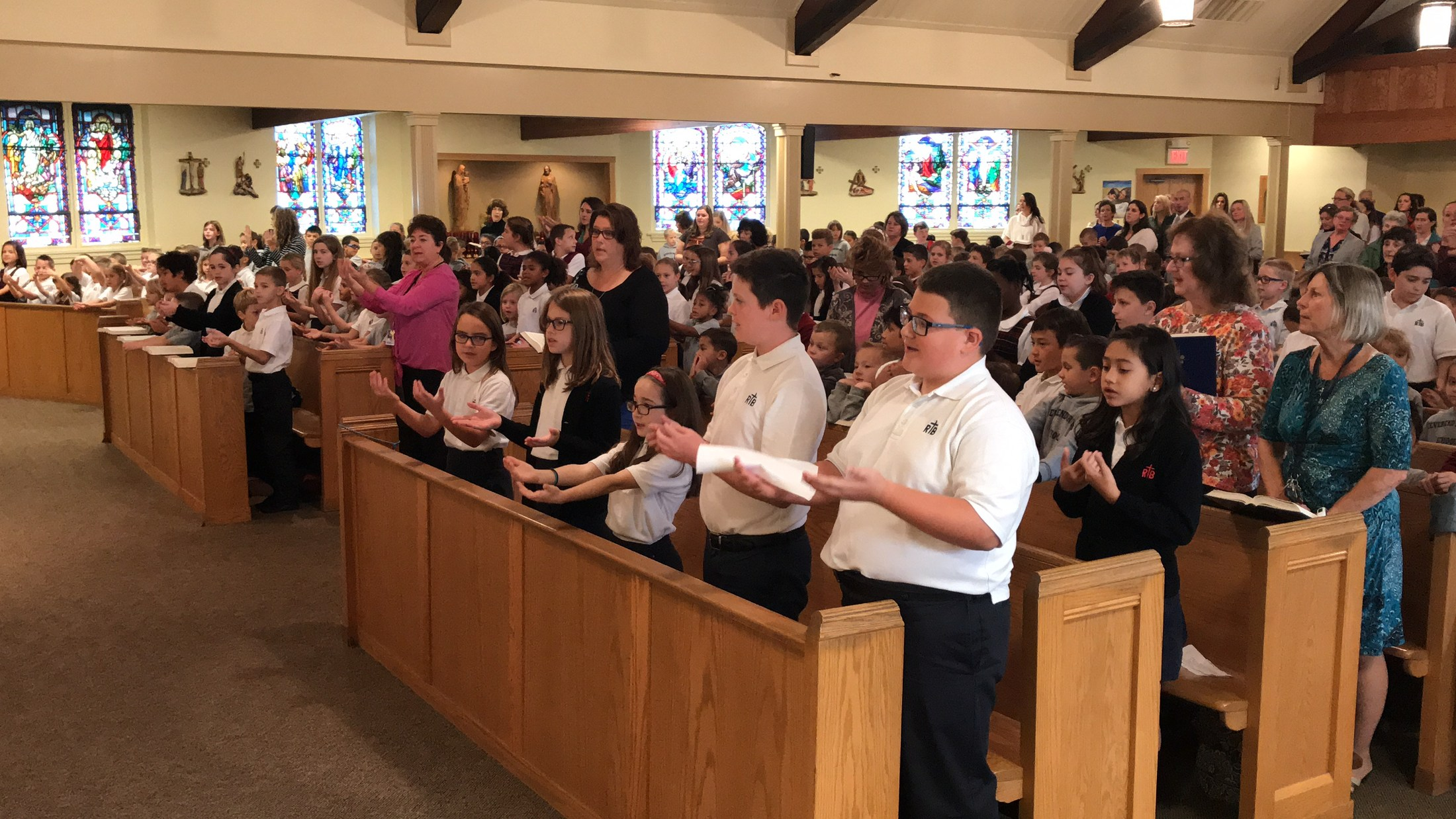 Students singing during mass