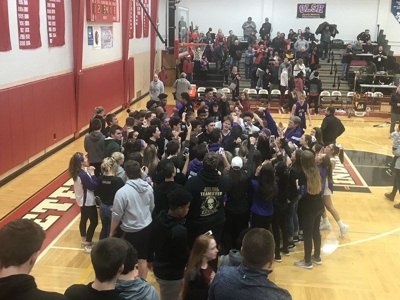 OLSH fans and basketball players celebrate on the court after winning the PIAA semifinal game in 2018.
