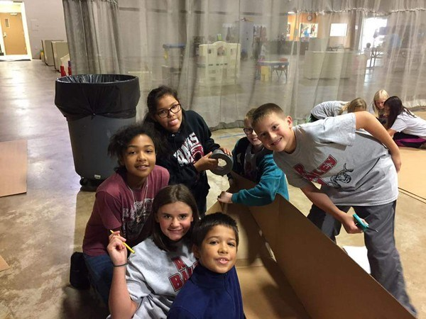 Students creating cardboard boat