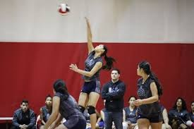 Union City Girls Volley Ball spiking a ball