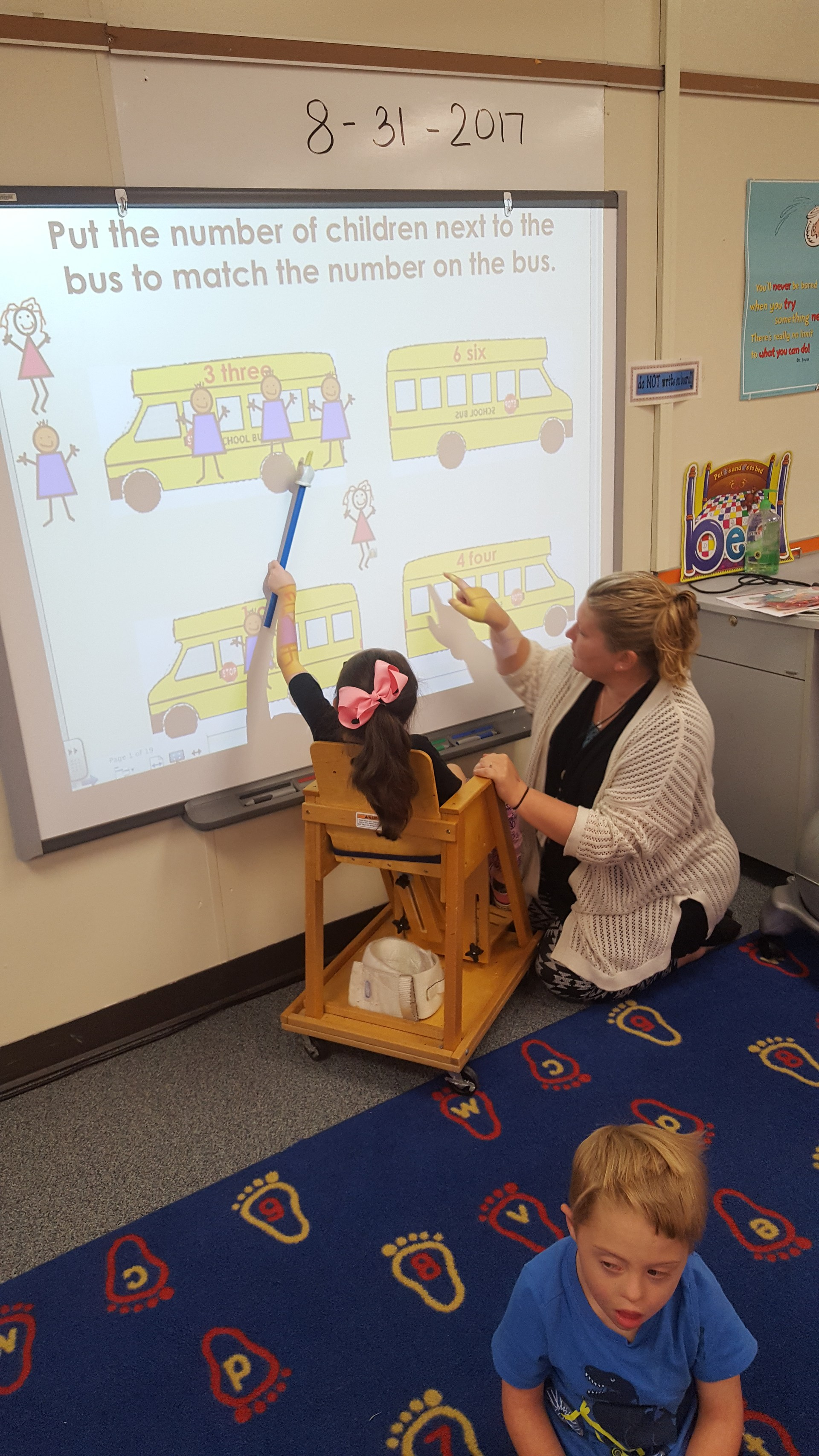 Dana Buie, TOY,  helping a student