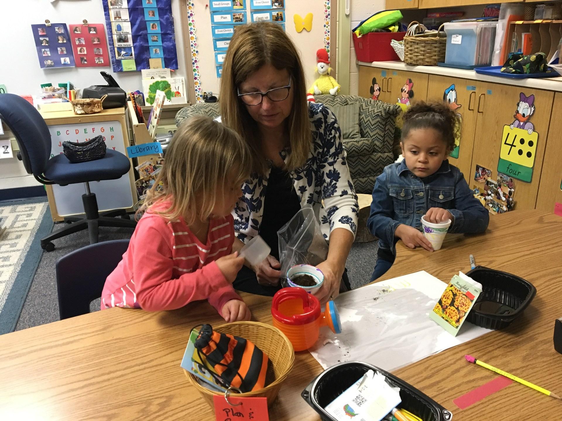 Preschooler planting seeds
