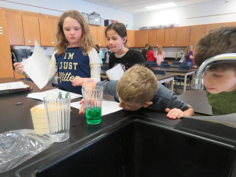 Page students are engaged in learning science.