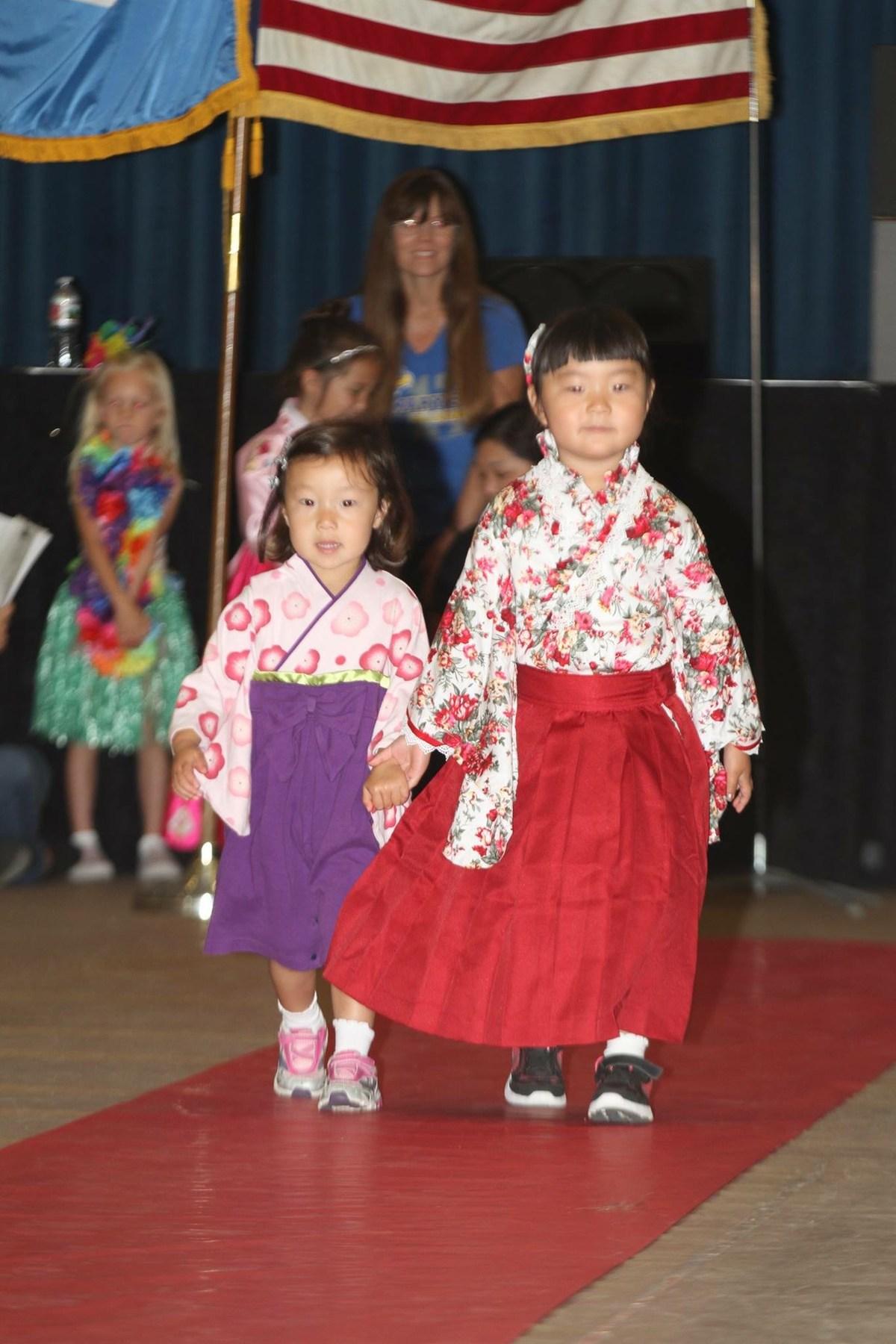 2 preschool sisters dressed in Japanese attire