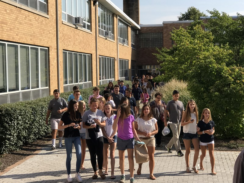 New students walking in courtyard