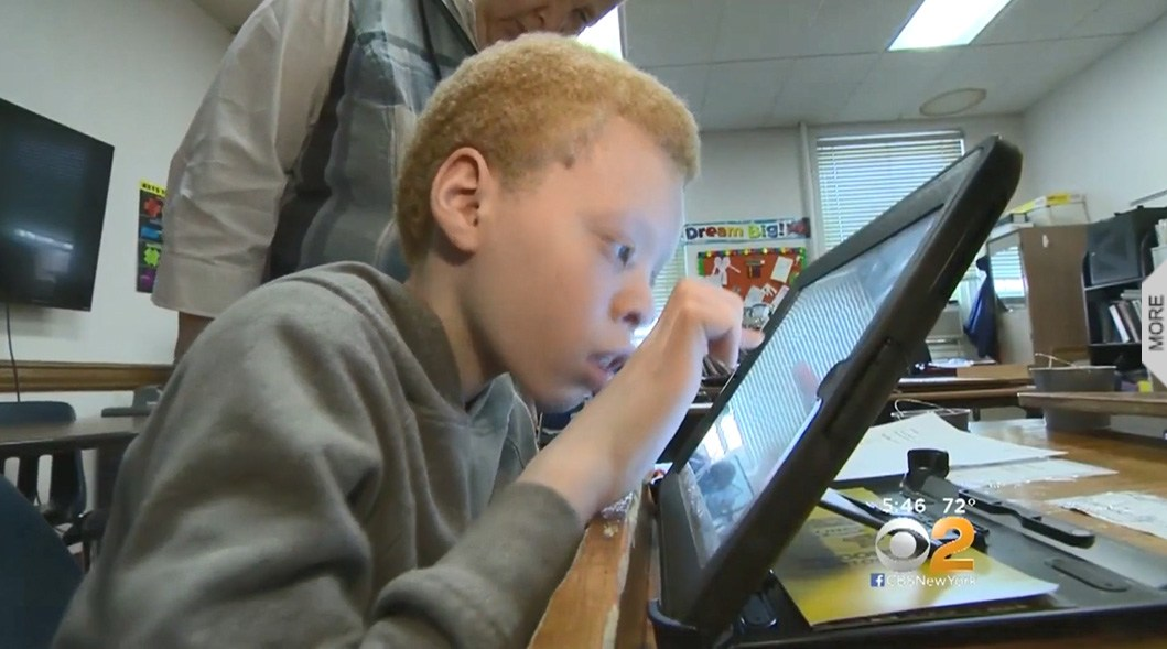 Middle school student with iPad