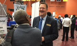 Lexington Two's Kevin Smoak, right, talks with potential candidates at a recent fair.